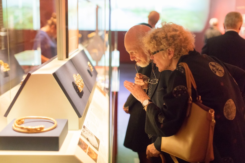 visitors admiring gold